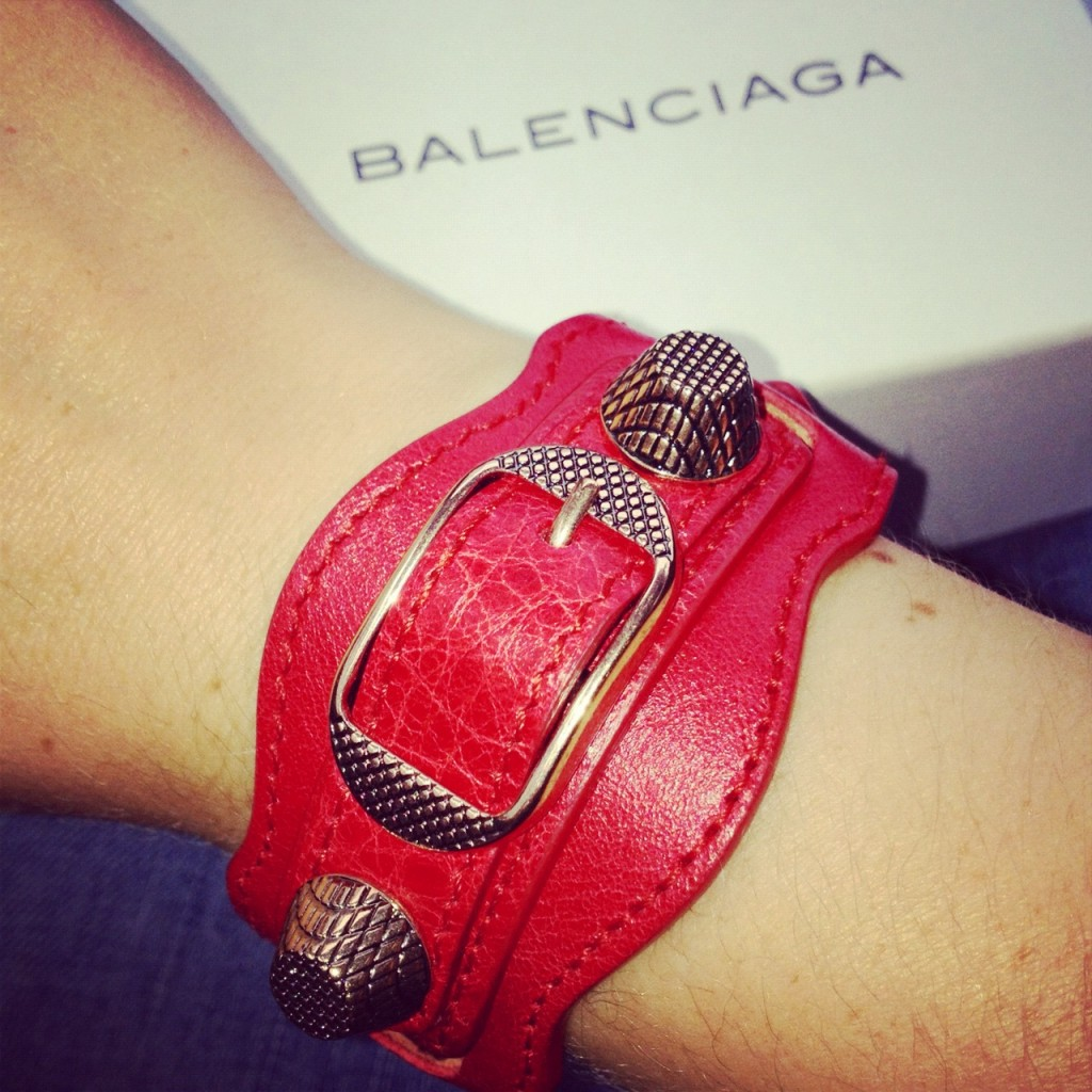 Red Balenciaga leather cuff with rose gold studs.