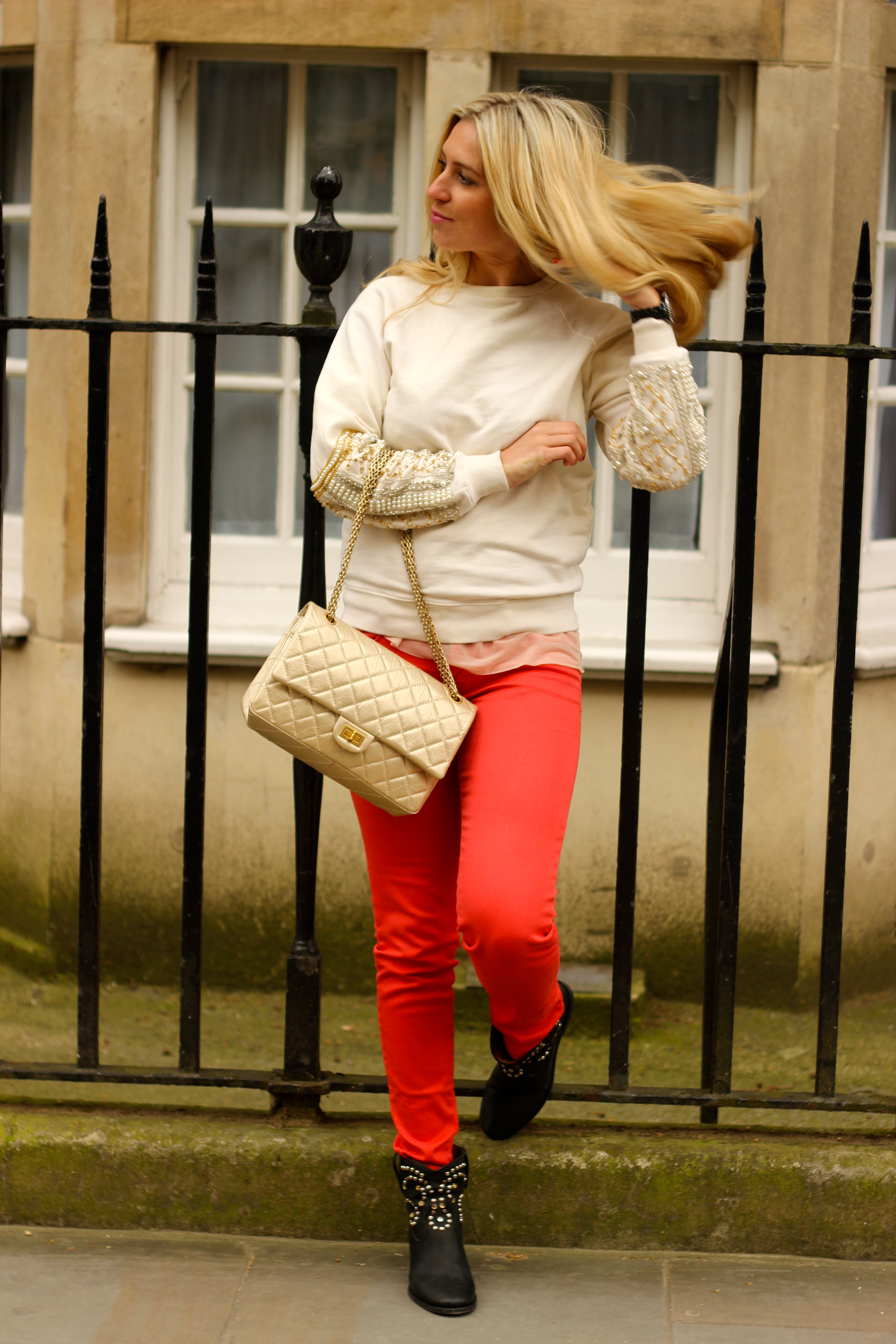 red denim trousers